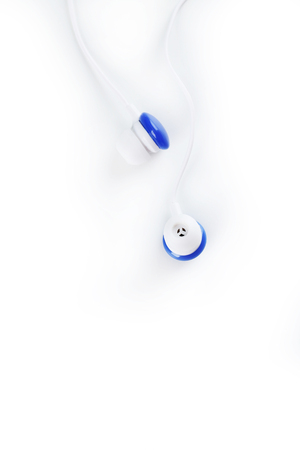 handsfree phone: White headphones isolated on a white