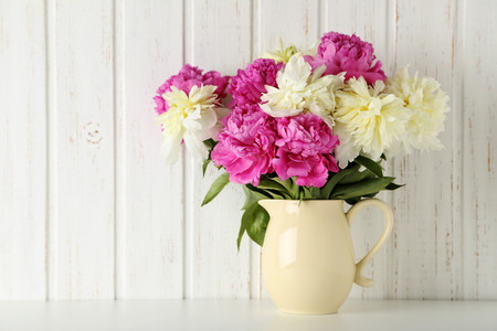 panelling: Bouquet of pink and white peony flowers on wal panelling background