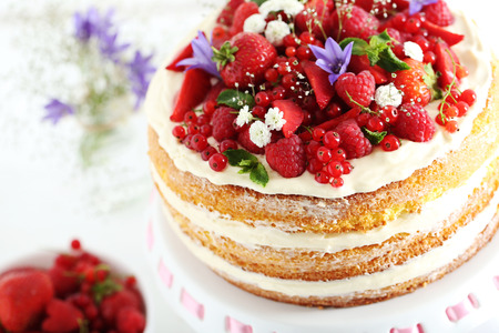 cake stand: Delicious biscuit cake with berries on cake stand
