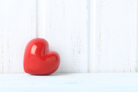 panelling: Red heart on blue wooden table