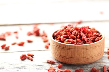 Dry goji berries on grey wooden table