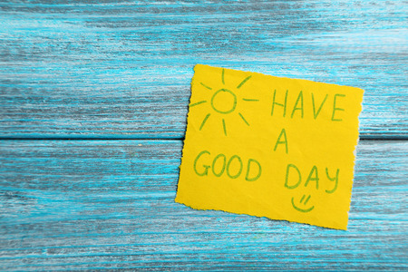 Piece of note paper on blue wooden background Stock Photo