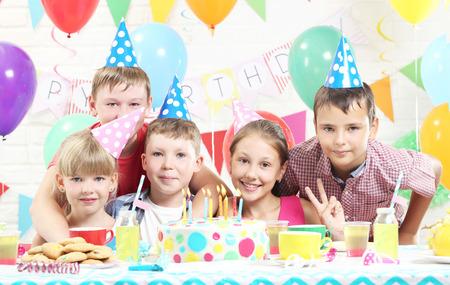 birthday presents: Happy kids having fun at birthday party