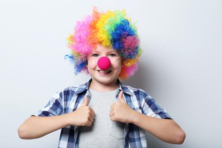 hairpiece: Portrait of  little boy clown on grey background Stock Photo