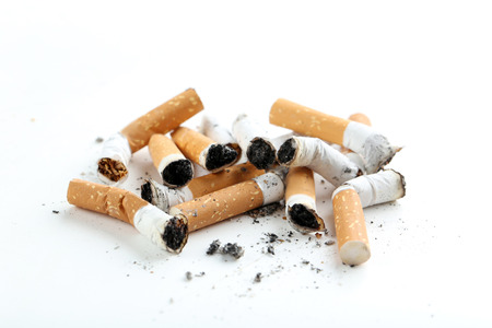 Cigarette butts with ash isolated on a white Stock Photo
