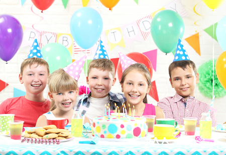 birthday party kids: Happy kids having fun at birthday party
