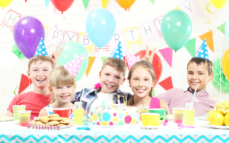 Happy kids having fun at birthday party