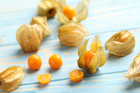 Ripe physalis on a blue wooden table Stock Photo