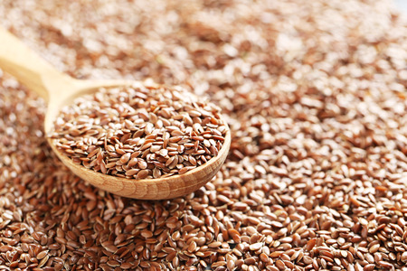 brown flax: Brown flax seeds in wooden spoon