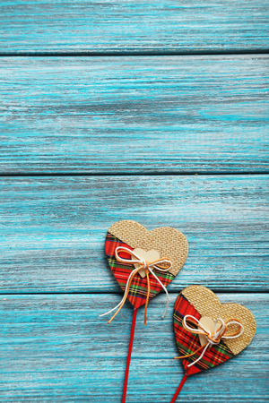 Love hearts on a blue wooden table