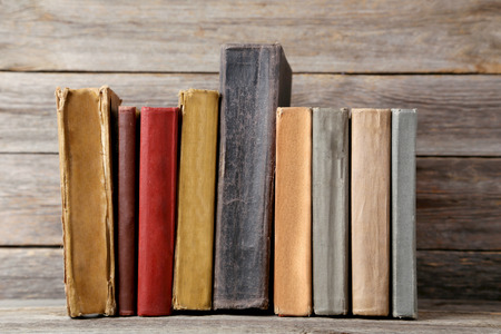 antique books: Old antique books on grey wooden table