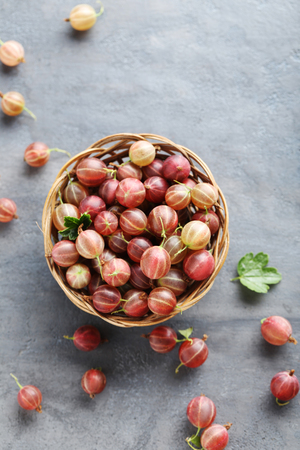 Gooseberries fruit on a grey table