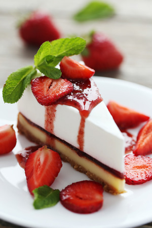 shortcake: Strawberry cheesecake on plate on grey wooden table