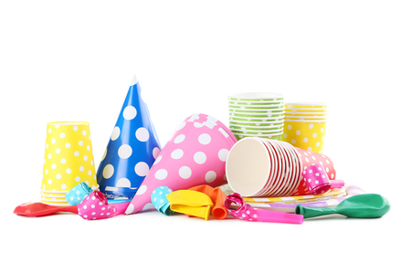 Birthday paper cups with caps, whistles and balloons isolated on a white Stock Photo
