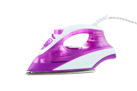 Electric iron isolated on a white