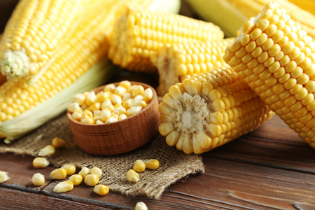 Sweet corns on a brown wooden table Stock Photo