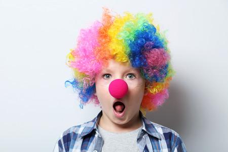 Portrait of  little boy clown on grey background Stock Photo