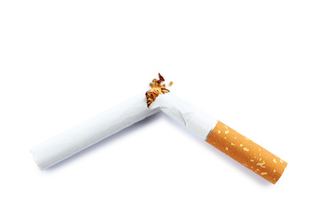 Broken cigarette isolated on a white