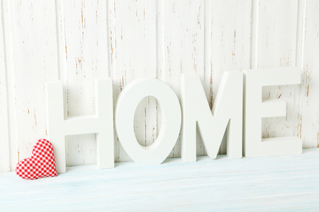 sweet heart: Word home of the decorative letters on wooden table