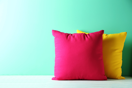 Colorful pillows on a blue wooden table