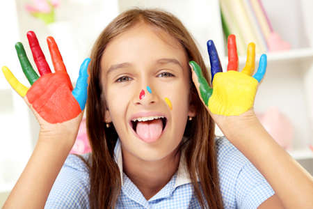 painted hands: Beautiful little girl with painted hands