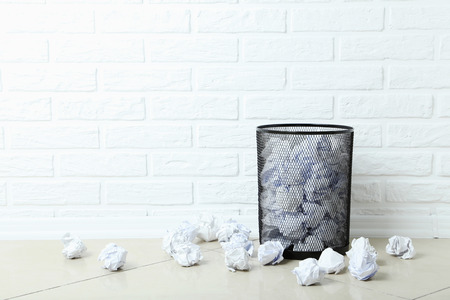 trashcan: Office trashcan with crumpled paper balls