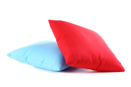 case sheet: Colorful pillows isolated on a white Stock Photo