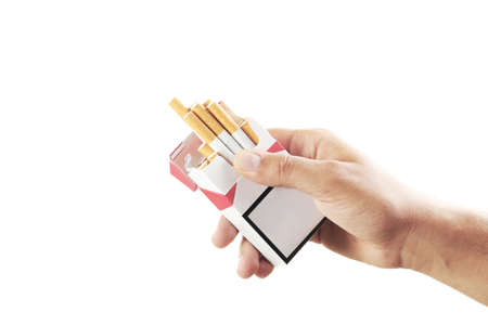 Male hand holding pack of cigarettes on white background