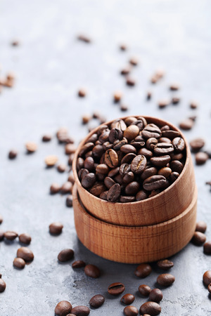 grained: Roasted coffee beans on a grey table