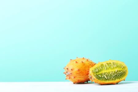 Kiwano fruit on white wooden table