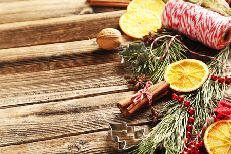 star anise christmas: Christmas tree branch with dried oranges, cinnamon and anise star on wooden table Stock Photo