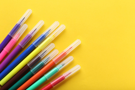 Felt-tip pens on a yellow background