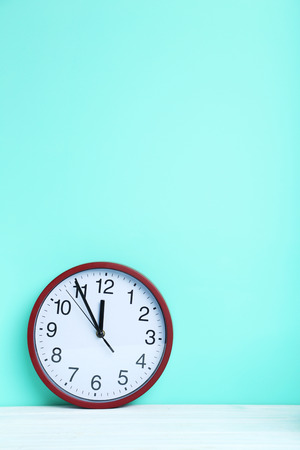 seconds: Red round clock on a mint background