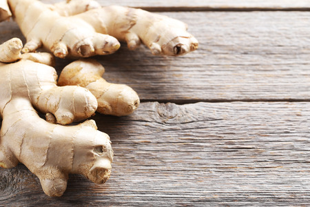 Ginger root on grey wooden table Stock fotó