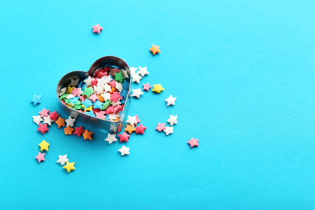 Colorful sprinkles on a blue background Stock Photo