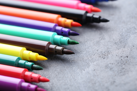 Felt-tip pens on a grey wooden table Stock Photo - 70054230