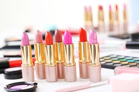 Colourful lipsticks on a white table