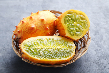 Kiwano fruit on grey wooden table Stock Photo