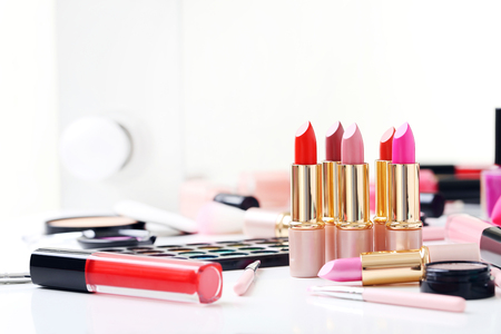 Different makeup cosmetics on white table Imagens