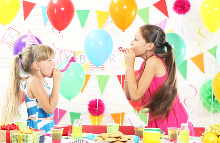 Happy childrens having fun at birthday party