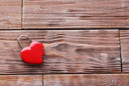 lockout: Heart shaped padlock on brown wooden table Stock Photo
