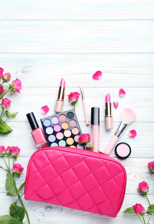 Different makeup cosmetics on white wooden table Imagens