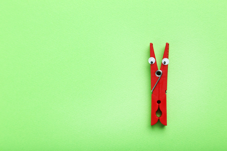 Plastic clothespin on a green background Stock Photo