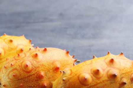 Kiwano fruit on grey wooden table Stock Photo