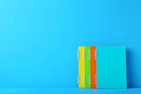 Colorful notebooks on blue background