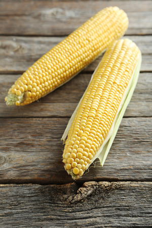 Sweet corns on a grey wooden table Stock Photo