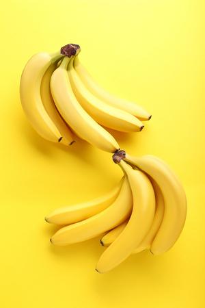 banana skin: Sweet bananas on the yellow background Stock Photo