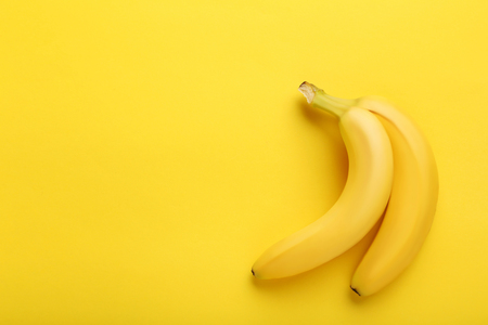 Sweet bananas on the yellow background Stock Photo