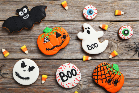 fresh halloween gingerbread cookies on grey wooden table stock photo 79087431 - Halloween Gingerbread Cookies