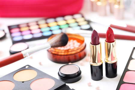 Different makeup cosmetics on white table Stock Photo